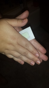 Rubbing between hands to warm up the wax!